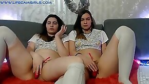 Twin sisters spread legs and fingering lovense