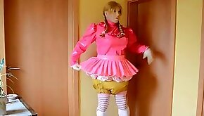 Transsexual sister in a short skirt and diapers