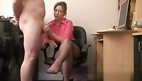 Busty cfnm MILF wanking off a butt naked dude in her office
