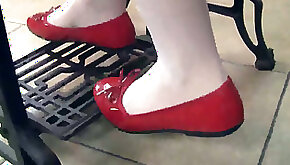 Pretty chick Petra wears red flats while working with machine
