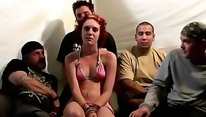 Red haired babe becomes a center of a crazy gang bang