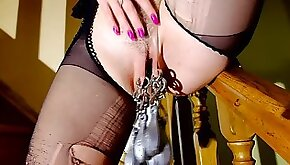 Blonde in high heels stretches pussy with piercings