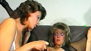Wild and dirty white sluts with excess makeup having lesbian sex