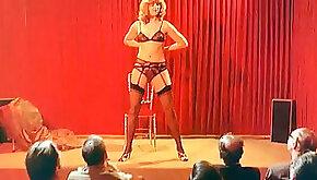 Blonde milf slut spreads her legs for three men on the chair