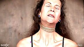 Mature BDSM submissive enjoys the pain of being tied up