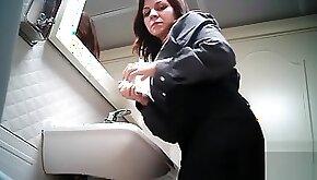 Women pee in public toilet